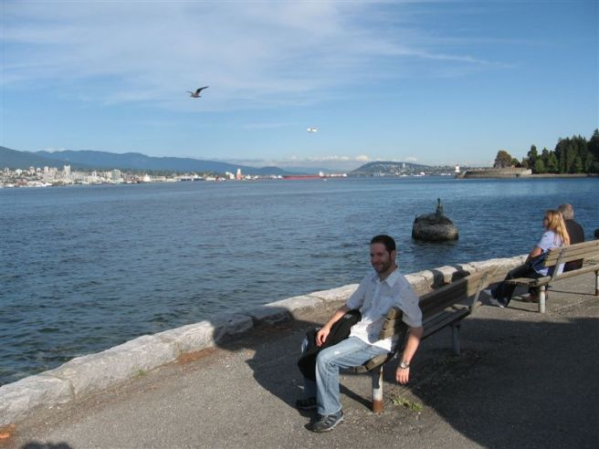 Jeremy in foreground, downtown Vancouver in background with mountains behind. Oh yeah, and lots of water in the middle - I forget the name of it - Horseshoe Bay, maybe. (Look, I never said I was a travel writer. :-D )