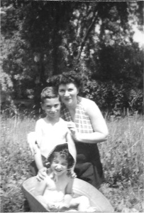 Mom, brother, and the little nightmare - summer of '47 in Val Morin. Look, he's daring to touch 'it'! :-D