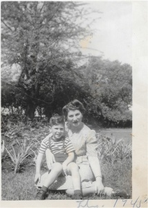 July 1945 - My mom cradling my big brother. The summer before his 'nightmare' was born.